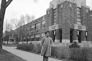 Full credit: Carl Wasaki/Life Images Collection/Getty Images  Linda Brown outside Sumner Elementary School in Topkea, Kansas, in 1953.
