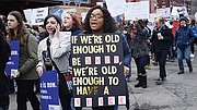 March For Our Lives participants make their way through lower Roxbury to the Boston Common.