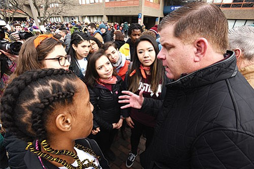 Mayor Martin Walsh talks with teens participating in the March For Our Lives event at Madison Park High School to show his support.