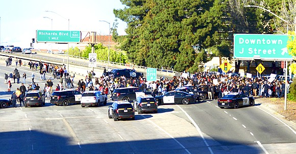 A protest over the fatal shooting of an unarmed Black man briefly shut down a major California interstate highway and ...