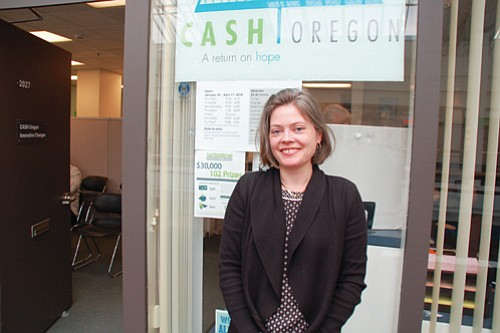 Sarah Adams, executive director of non-profit CASH Oregon, welcomes low income families and individuals to offices on the third floor of the Lloyd Center where they can get free help to prepare their taxes and claim an Earned Income Tax Credit.