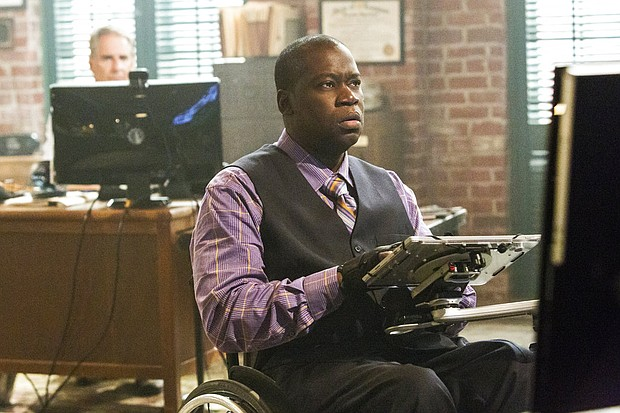 """Disabled actor Daryl Mitchell in a scene from """"NCIS: New Orleans."""" Mitchell, who is paralyzed as a result of a motorcycle accident in 2001, has starred in a variety of films and TV series. He is currently a series regular on the """"NCIS"""" spin-off series. (Skip Bolen/CBS via AP)"""