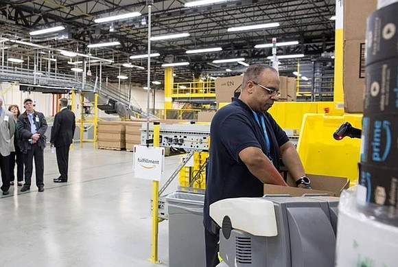 Amazon recently opened its doors for the first time to its first robotics center in Illinois.