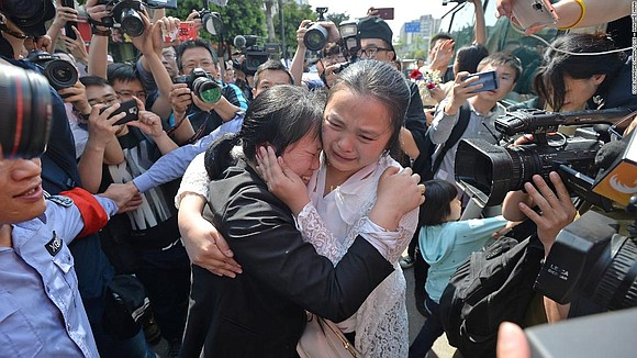 The extraordinary story of a married Chinese couple reuniting with their daughter nearly 24 years after she went missing has ...