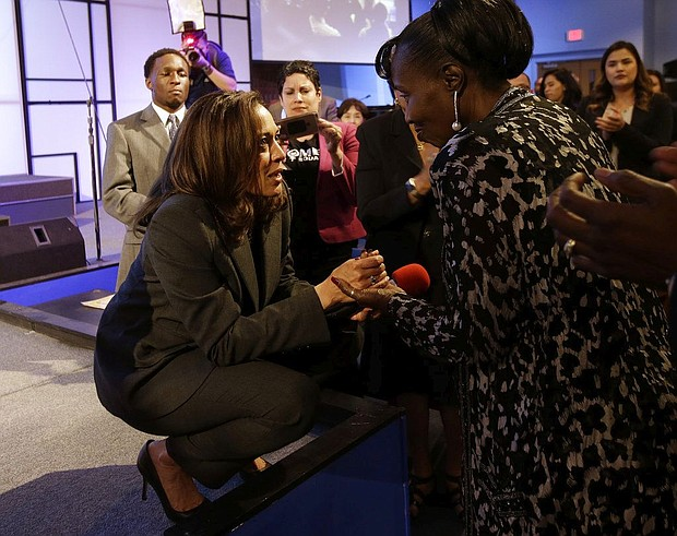 U.S. Sen. Kamala Harris, D-Calif., left, talks with Sequita Thompson, the grandmother of Stephon Clark, who was shot and killed by Sacramento police, during a town hall meeting Thursday, April 5, 2018, in Sacramento, Calif. (AP Photo/Rich Pedroncelli)