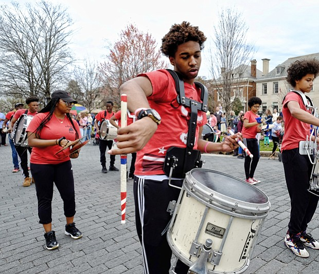 The Ephesus Pathfinder Drumline, above, strikes up a beat that gets spectators grooving as the group parades and plays down the avenue.