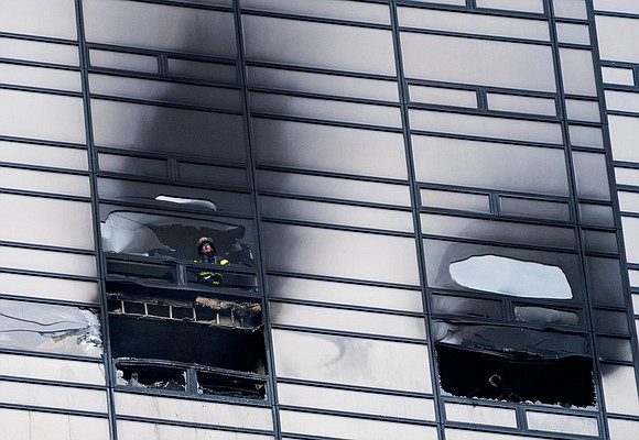 A raging fire that tore through a 50th-floor apartment at Trump Tower killed a man inside and sent flames and ...