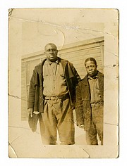 """James """"Big Jim"""" Richardson, left, is photographed at Free Soil Camp in 1936 in Michigan. The university has acquired a trove of photos capturing a place and time largely overlooked by history: black Civilian Conservation Corps camps during the Great Depression. The photos are the only known images of the state's segregated, all-black camps. President Franklin Roosevelt established the corps in the early 1930s to employ a """"vast army"""" of unemployed men and restore national resources. (Bentley Historical Library via AP)"""
