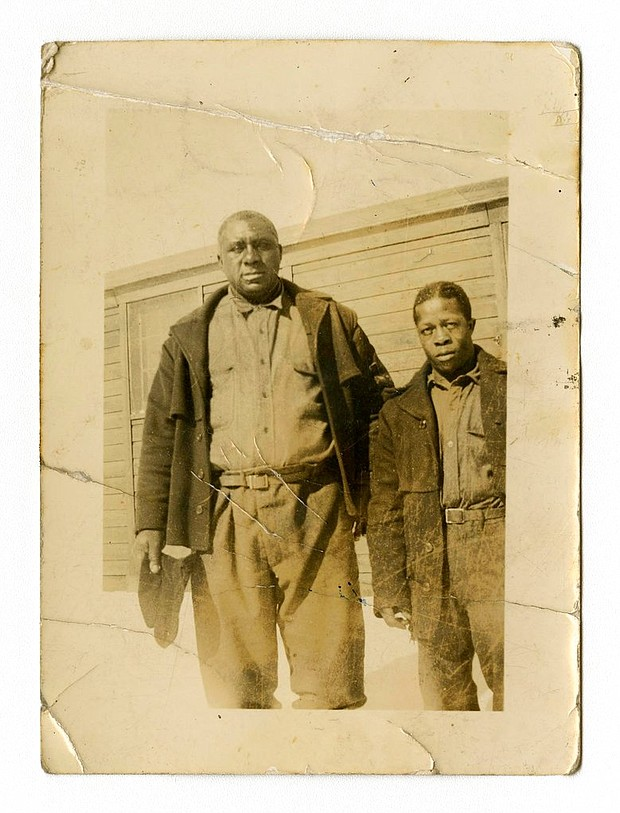 "James ""Big Jim"" Richardson, left, is photographed at Free Soil Camp in 1936 in Michigan. The university has acquired a trove of photos capturing a place and time largely overlooked by history: black Civilian Conservation Corps camps during the Great Depression. The photos are the only known images of the state's segregated, all-black camps. President Franklin Roosevelt established the corps in the early 1930s to employ a ""vast army"" of unemployed men and restore national resources. (Bentley Historical Library via AP)"