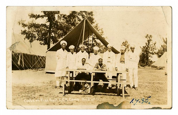Cooks of Free Soil Civilian Conservation Corps are photographed in 1935 in Michigan. The university has acquired a trove of photos capturing a place and time largely overlooked by history: black CCC camps during the Great Depression. The photos are the only known images of the state's segregated, all-black camps. (Bentley Historical Library via AP)