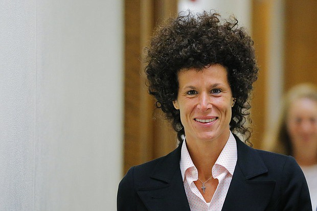 In this June 16, 2017 file photo, accuser Andrea Constand exits the courtroom during deliberations in Bill Cosby's sexual assault trial at the Montgomery County Courthouse in Norristown, Pa. Constand, 44, managed the women's basketball team at Cosby's alma mater, Temple University. She met Cosby there in 2002 and said he drugged and molested her in early 2004. (Lucas Jackson/Pool Photo via AP, File)