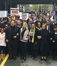 Martin Luther King III, fourth from left, leads the March for Humanity, Monday, April 9, 2018, in Atlanta. The march commemorates the funeral procession of Dr. Martin Luther King Jr., 50 years ago. To the right of King is Kerry Kennedy, daughter of Robert Kennedy and Bernice King, daughter of Dr. King. To the left is his daughter Yolanda Renee King and Jaclyn Corin, an organizer of March for Our Lives. Behind King is the Rev. Al Sharpton. (AP Photo/Jonathan Landrum)