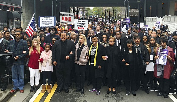 Relatives of the Rev. Martin Luther King Jr. led more than 1,000 people on a march Monday in downtown Atlanta, ...