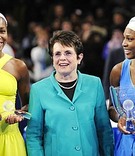 In this March 2, 2009, file photo, Billie Jean King is flanked by Venus, left, and Serena Williams after Serena defeated Venus in the championship match of the Billie Jean King Cup tennis exhibition, at Madison Square Garden in New York. (AP Photo/Stephen Chernin, File)