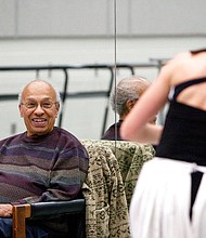 "In this Jan. 25, 2012 photo provided by the University of California, Irvine, Donald McKayle watches a dancer in a studio on the campus of the UCI. McKayle, a modern dancer and choreographer who brought the black experience in America to the Broadway stage in musicals such as ""Raisin"" and ""Sophisticated Ladies,"" has died. He was 87. (Michelle S. Kim/UCI via AP)"