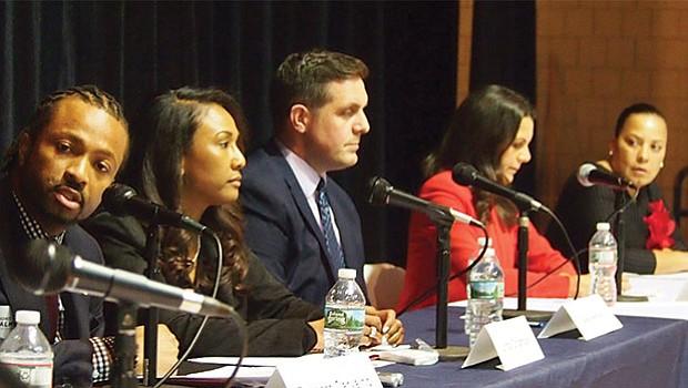 Evandro Carvalho speaks as Linda Champion, Greg Hennings, Shannon McAuliffe and Rachael Rollins look on.