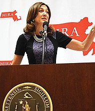 Eva Millona, executive director of the MIRA Coalition, gives remarks at 2018 Immigrants' Day event.