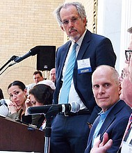 Former Education Secretary Paul Reville leads a panel discussion.