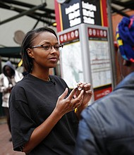 Leah Hill, a behavioral health fellow with the Baltimore City Health Department, demonstrates how to administer Narcan nasal spray in the event of a possible opioid overdose. The overdose-reversal drug is a critical tool to easing America's coast-to-coast opioid epidemic. (AP Photo/Patrick Semansky)