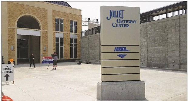 Joliet's Gateway train station opened to commuters on Wednesday with morning riders greeted with free coffee and doughnuts from city staff and public officials.