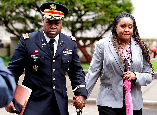 In this May 9, 2013, file photo, John Jackson, left, and his wife, Carolyn Jackson, walk out of Martin Luther King Jr. Courthouse in Newark, N.J. The Jacksons, convicted of abusing their young foster children, received additional punishment on Thursday, April 12, 2018, during a resentencing prompted by an appeals court's ruling that their initial sentences were insufficient and didn't properly apply federal guidelines. (AP Photo/Julio Cortez, File)