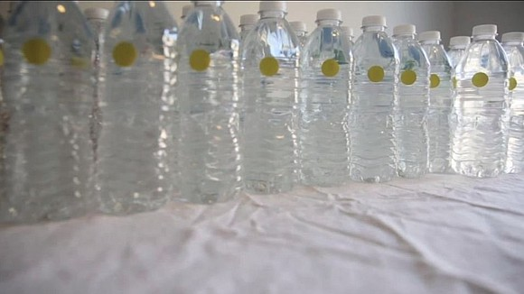 Dozens of Flint, Michigan, residents angry about the state's decision to end a free bottled water program took their outrage ...