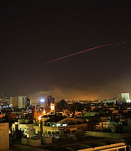 Explosions lit up the skies with anti-aircraft fire, over Damascus, the Syrian capital, as the U.S. launches an attack on Syria targeting different parts of the Syrian capital Damascus, Syria, early Saturday, April 14, 2018. (AP Photo/Hassan Ammar)