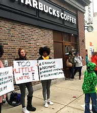 Protesters gather outside a Starbucks in Philadelphia, Sunday, April 15, 2018, where two black men were arrested Thursday after Starbucks employees called police to say the men were trespassing. The arrest prompted accusations of racism on social media. (AP Photo/Ron Todt)