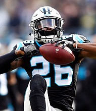 This Dec. 17, 2017 file photo shows Carolina Panthers' Daryl Worley celebrating his interception against the Green Bay Packers in Charlotte, N.C. The Philadelphia Eagles have released Worley hours after he was arrested. NFL Network reported that Worley was arrested Sunday, April 15, 2018 near the team's practice facility and that police used a Taser on him after he became combative. (AP Photo/Mike McCarn)