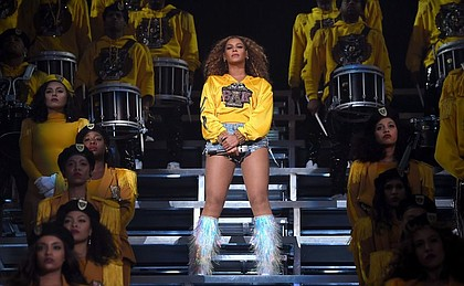 Beyoncé's headlining performance at Coachella, one year after it was originally scheduled. Force and determination were evident throughout the two-hour concert. (Credit: Larry Busacca/Getty Images)