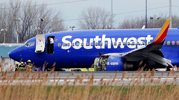Passengers aboard a Dallas-bound Southwest Airlines flight Tuesday heard an explosion before seeing oxygen masks drop from the ceiling and ...