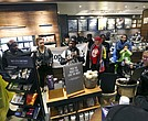 Demonstrators occupy the Starbucks that has become the center of protests Monday, April 16, 2018, in Philadelphia. (AP Photo/Jacqueline Larma)