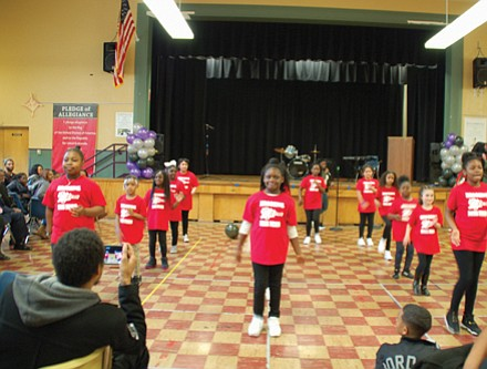 The student drill team at Martin Luther King Jr. School performs at Friday's celebration honoring the 50 years of legacy since the school was named in honor of King.
