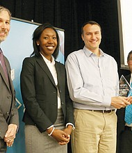 Key employers who help Portland Community College educate and train a skilled workforce are honored during a recent Employer Partnership Awards celebration. Pictured, (from left) are Mark Goldberg, associate vice president of PCC Workforce Development and Continuing Education; Kali Thorne Ladd, PCC board chair; Jesse Brough, owner of Blessing Landscape; and PCC President Mark Mitsui.