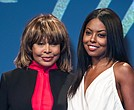 In this Tuesday, Oct. 17, 2017 file photo, Tina Turner, left, poses for photographers with actress Adrienne Warren, who plays Turner, during a photo call to promote the launch of the musical 'Tina', in London. (Photo by Vianney Le Caer/Invision/AP, File)