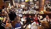 Ministers and rabbis stage a sit-in at the Center City Starbucks in Philadelphia to protest the arrest of two African-American men who were waiting at the coffee shop for a friend to arrive. The protest reflects the backlash against the company over the incident. The manager who called police to remove the alleged trespassers no longer works at the cafe.