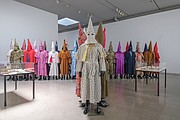 "Artist Paul Rucker's work, ""Storm in the Time of Shelter,"" reimagines Ku Klux Klan robes using materials such as kente cloth."