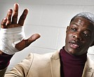 James Shaw Jr., shows his hand that was injured when he disarmed a shooter inside a Waffle House on Sunday, April 22, 2018, in Nashville, Tenn. A gunman stormed the Waffle House restaurant and shot several people to death before dawn, according to police, who credited Shaw, a customer with saving lives by wresting the assailant's weapon away. (Larry McCormack/The Tennessean via AP)