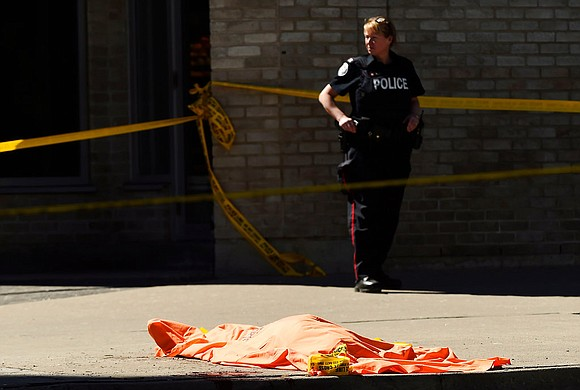 A rented van jumped onto a crowded Toronto sidewalk Monday, killing nine people and injuring 16 before the driver fled ...