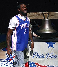 Rapper Meek Mill comes out to ring a Liberty Bell replica before the first half of Game 5 between the Miami Heat and the Philadelphia 76ers, Tuesday, April 24, 2018, in Philadelphia. (AP Photo/Chris Szagola)