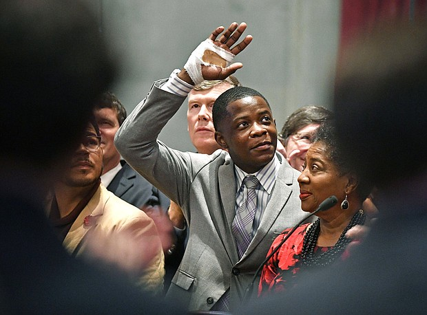 James Shaw Jr., waves to the crowd and legislators inside the Tennessee House chambers as he is honored for disarming a shooter inside a Nashville-area Waffle House at the Tennessee State House Tuesday April 24, 2018, in Nashville, Tenn. (Larry McCormack/The Tennessean via AP)