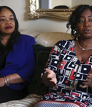 Sandra Thompson, right, speaks alongside Sandra Harrison, both golfers and members of a group of local women known as Sisters in the Fairway, during an interview with The Associated Press, Tuesday April 24, 2018 in York, Pa. (AP Photo/Jacqueline Larma)