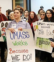 UMass Boston students, faculty and staff flood Interim Chancellor Barry Mills' office to deliver petitions.