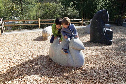 Kids play on a camel sculpture in the newly reinstalled Warren J. Iliff Sculpture Garden at the Oregon Zoo. The ...