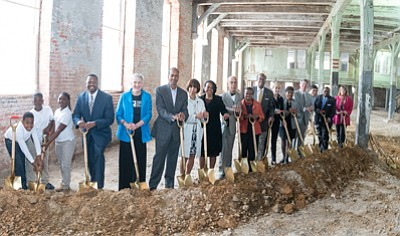 School children, residents, elected officials celebrate transformation of long-vacant Hoen buildings into a problem-solving center for neighborhoods.
