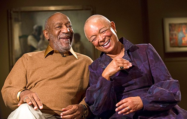 "In this Nov. 6, 2014, file photo, Bill Cosby and his wife, Camille, laugh as they tell a story about collecting a piece in the exhibit ""Conversations: African and African-American Artworks in Dialogue,"" at the Smithsonian Institution's National Museum of African Art in Washington. Cosby was convicted of drugging and molesting a woman in the first big celebrity trial of the #MeToo era, completing the spectacular late-life downfall of a comedian who broke racial barriers in Hollywood on his way to TV superstardom as America's Dad. (AP Photo/Evan Vucci, File)"