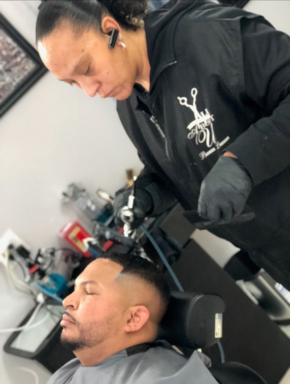 When LaToya Medina opened up a barber lounge in Joliet last year, she knew she wanted to aim a cut ...
