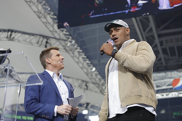 Australian rugby player Jordan Mailata, right, appears onstage after being selected by the Philadelphia Eagles in the 7th round of the NFL Draft, Saturday, April 28, 2018 in Arlington, Texas. (Doug Benc/AP Images)