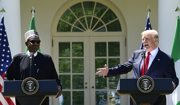 President Donald Trump, right, speaks during a news conference with Nigerian President Muhammadu Buhari, left, in the Rose Garden of the White House in Washington, Monday, April 30, 2018. (AP Photo/Susan Walsh)