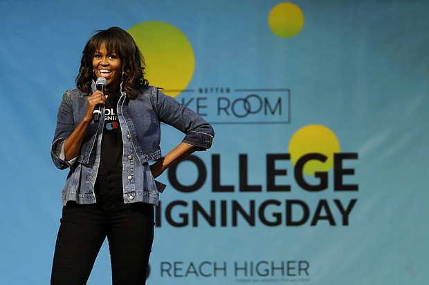 Former first lady Michelle Obama speaks at College Signing Day, an event honoring Philadelphia students for their pursuit of a college education or career in the military, Wednesday, May 2, 2018, at Temple University in Philadelphia. (AP Photo/Matt Slocum)